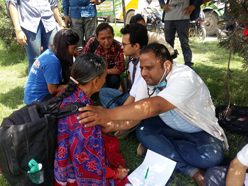 Resident doctors of Tribhuvan University Teaching Hospital (TUTH), who halted their service at the hospital, provide free health check-up as they continue their strike in support of Dr Govinda KC, at Maitighar Mandala, in Kathmandu, on Friday, July 13, 2018. Photo: Anita Shrestha/THT