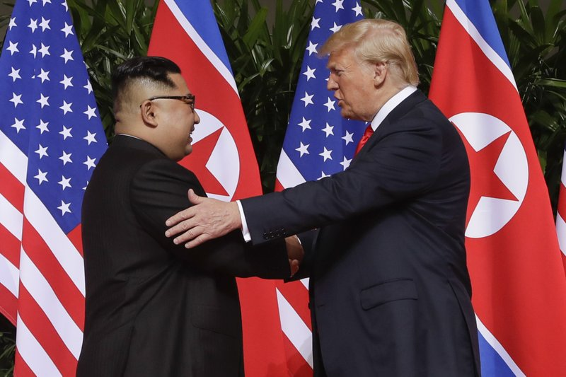 File - In this photo, U. S. President Donald Trump shakes hands with North Korea leader Kim Jong Un at the Capella resort on Sentosa Island in Singapore on Tuesday, June 12, 2018. Photo: AP