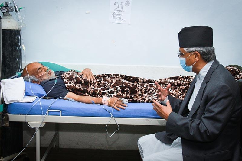 Nepali Congress President Sher Bahadur Deuba visiting Dr Govinda KC, who has been staging a fast-unto-death since June 30, at Tribhuvan University Teaching Hospital, in Kathmandu, on Friday, July 21, 2018. Photo: THT