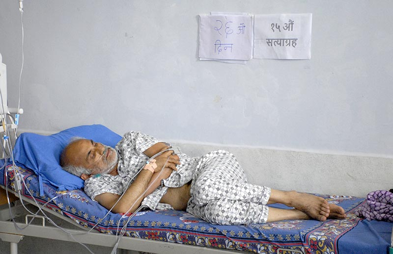 Dr Govinda KC lying on a bed on the 26th day  of his hunger strike at TU Teaching Hospital, Maharajgunj, in Kathmandu, on Wednesday, July 25, 2018. Photo: Naresh Shrestha/THT