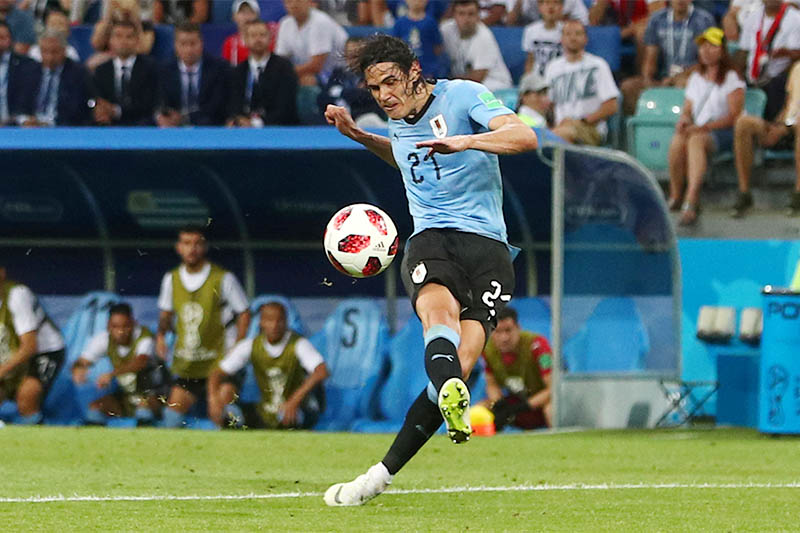 Uruguay's Edinson Cavani scores their second goal. Photo: Reuters