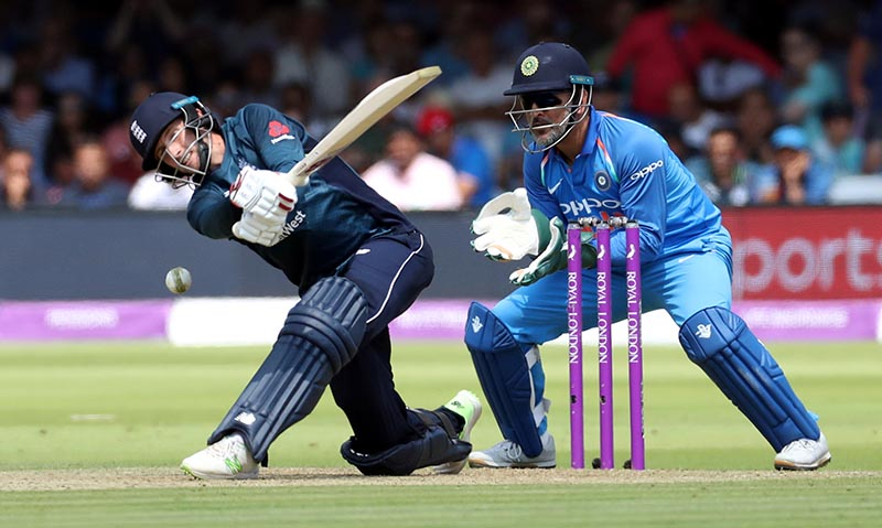 England's Joe Root in action as India's MS Dhoni looks on during the Second One-Day International match between England and India, at Lord's Cricket Graound, in London, Britain, on July 14, 2018. Photo: Action Images via Reuters