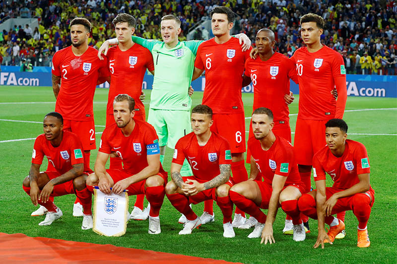 England players pose for a team group photo before the match. Photo: Reuters
