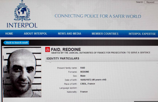 An undated screen shot of a red corner notice issued by INTERPOL for arrest of Redoine Faid. Photo: Interpol