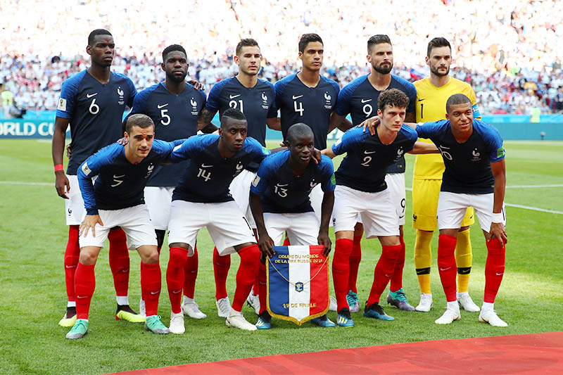 France players pose for a team group photo before the match. Photo: Reuters