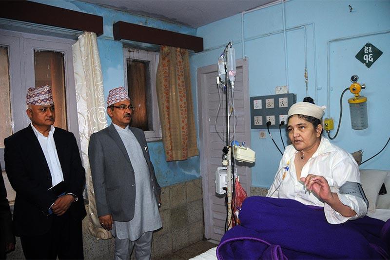 Ganga Maya Adhikari (right), mother of deceased Krishna Prasad Adhikari, at Intensive Care Unit of Bir Hospital, in Kathmandu, on Monday, July 9, 2018. Photo: Balkrishna Thapa Chhetri/THT