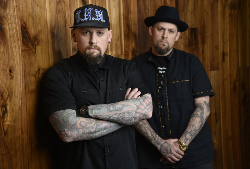 File - This photo shows Benji Madden, left, and his twin brother Joel Madden of the rock band Good Charlotte in Burbank, California on  July 10, 2018. Photo: AP