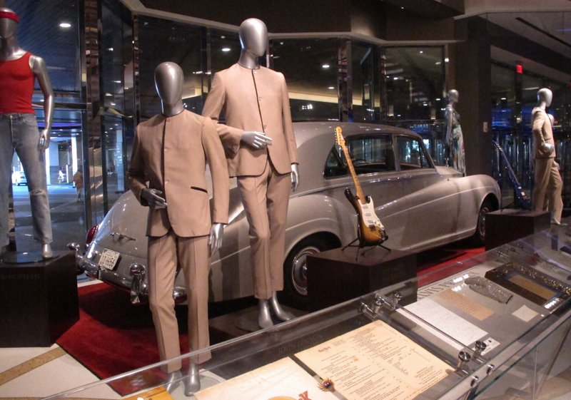 This photo shows suits worn by the Beatles during an early tour of America in front of the Rolls Royce automobile owned by Elvis Presley, part of a large collection of music memorabilia on display at the Hard Rock casino in Atlantic City, N.J. on July 5, 2018. Photo: APn