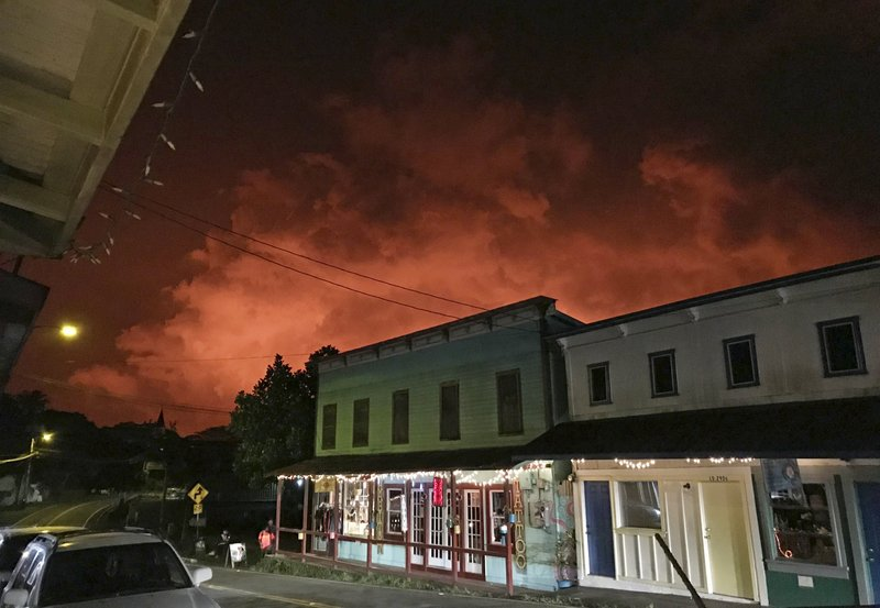 In this photo provided by Nathan Kam, a glow from the eruption of the Kilauea volcano is seen over Pahoa, Hawaii on Monday, July 16, 2018. Photo: AP