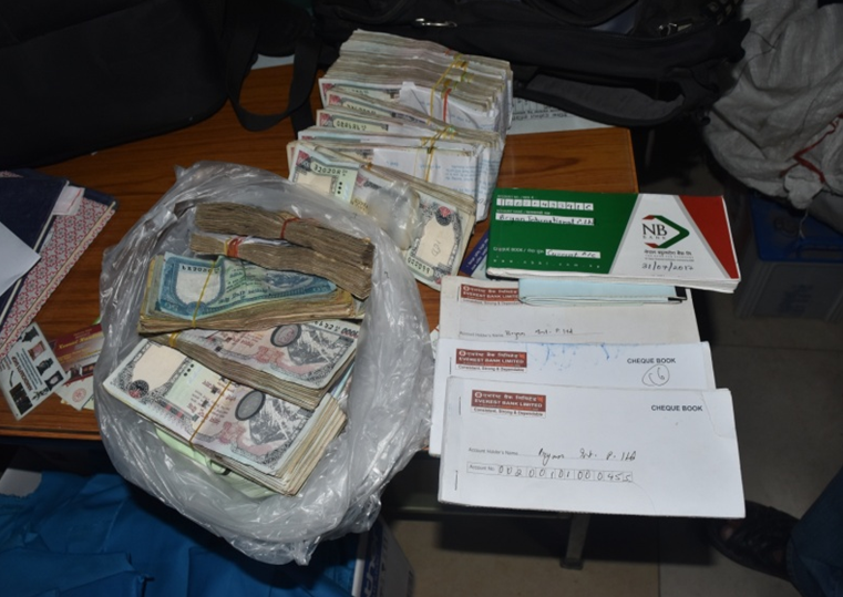 Police display cash and chequebooks and other transaction records seized from five hundi operators from Kathmandu on July 23, 2018. Photo: Metropolitan Crime Division