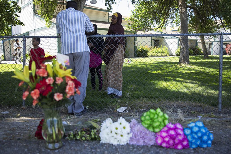 Ibod Hasn (centre), talks to a friend who came to visit after Saturday's stabbing attack in Boise, Idaho, Sunday, July 1, 2018. Photo: AP