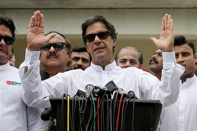 Cricket star-turned-politician Imran Khan, chairman of Pakistan Tehreek-e-Insaf (PTI), speaks to members of media after casting his vote at a polling station during the general election in Islamabad, Pakistan, July 25, 2018. Photo: Reuters
