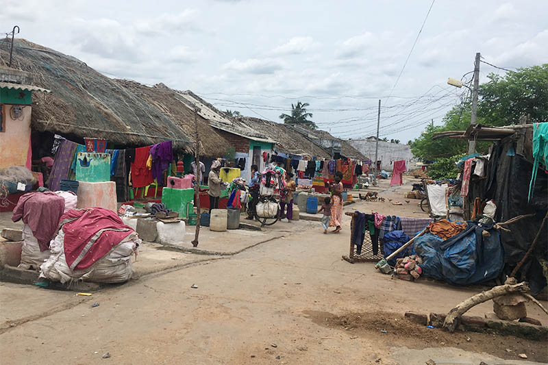 Homes in a fisherman's colony where residents have received titles to their properties through a programme to give land rights to slum dwellers in Odisha state in India. July 5, 2018. Photo: Reuters