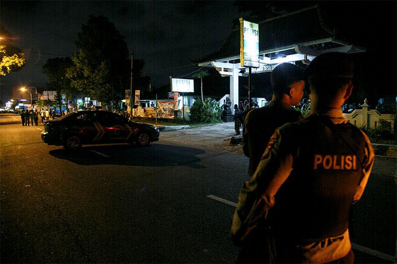 Indonesian police guard is seen near the scene of a shooting in Sleman, Yogyakarta, Indonesia, on  July 14, 2018. Photo: Antara Foto/ Hendra Nurdiyansyah via Reuters