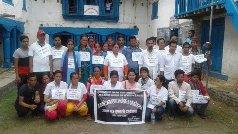 Health workers of Jajarkot District Hospital staging a sit-in after they were deprived of salary for the last five months, in front of the District Administration Office, Jajarkot, on Wednesday, July 11, 2018. Photo: THT