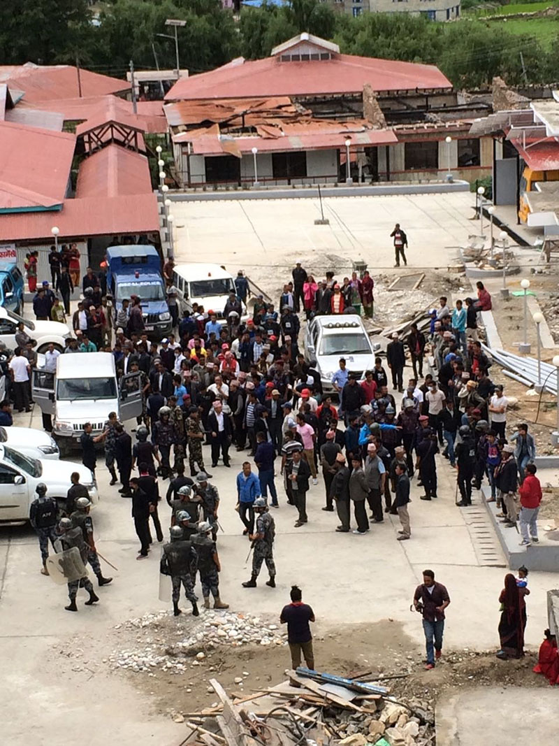 Security personnel trying to contain the protesters on the premises of Karnali Academy of Health Sciences, in Jumla, on Thursday, July 19, 2018. Photo: Pritam Subedi