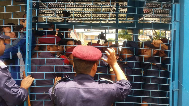 Security personnel try to contain the protesters at the premises of Karnali Academy of Health Sciences, in Jumla, on Thursday, July 19, 2018. Photo: Pritam Subedi