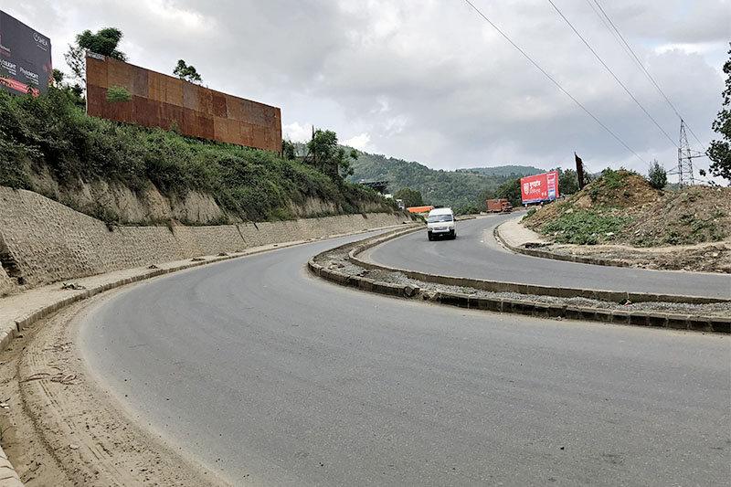 A vehicle is seen plying at Nagdhunga along Kalanki--Nagdhunga road section in Chandragiri Municipality, on the western outskirts of Kathmandu, on Sunday, July 22, 2018. The much delayed road expansion project along the highway is yet to be completed. Photo: Mausam Shah Nepali