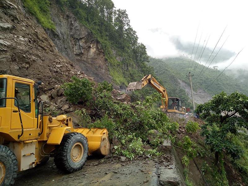 An excavator and a loader are seen removing landslide debris at Kali Khola, in Chitwan district, on Wednesday, July 4, 2018.  Photo: Tilak Ram Rimal/THT