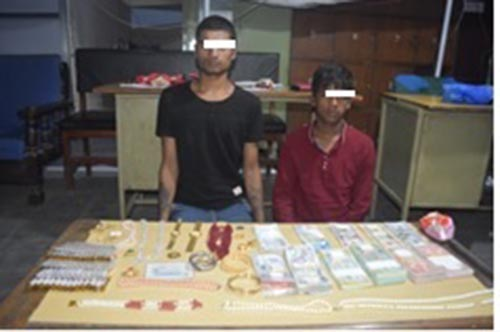 Metropolitan Police Crime Division make public two burglars along with stolen properties nabbed on Friday from a house in Dallu Residential Area, in KMC-15, on Sunday, July 8, 2018. Various gangs of Indian nationals under the guise of scrap collectors are involved in housebreaking in Kathmandu Vall recently. Photo: MPCD