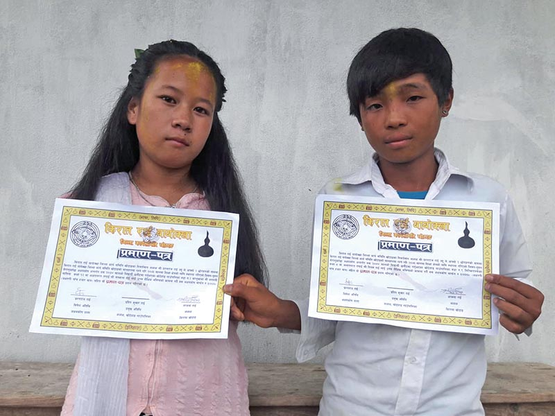 Differently-abled students posing for a photo after receiving scholarship, in Khotang, on Saturday. Photo: THT