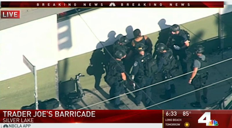 In this image from video provided by KNBC-TV, officers take a suspect into custody outside a Trader Joeu2019s supermarket in the Silver Lake district of Los Angeles on Saturday, July 21, 2018. Photo: AP