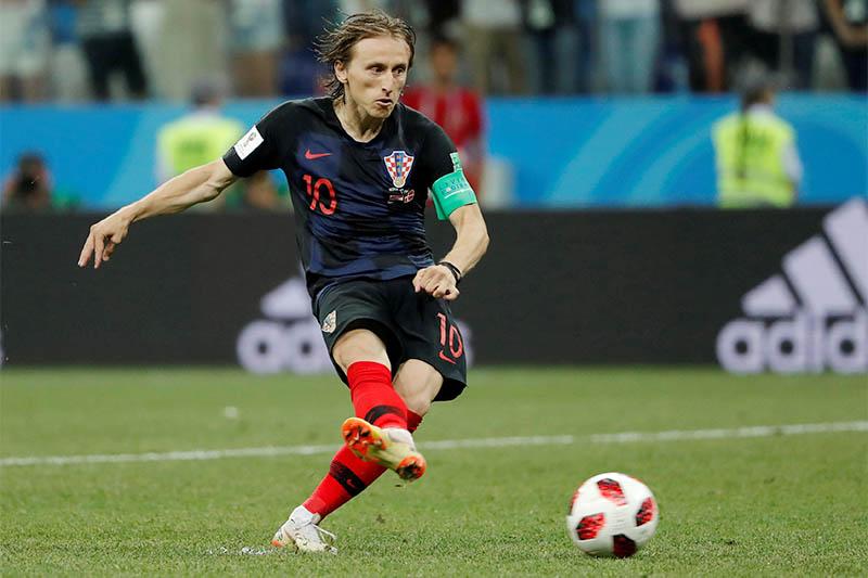 Croatia's Luka Modric scores a penalty during the shootout. Photo: Reuters