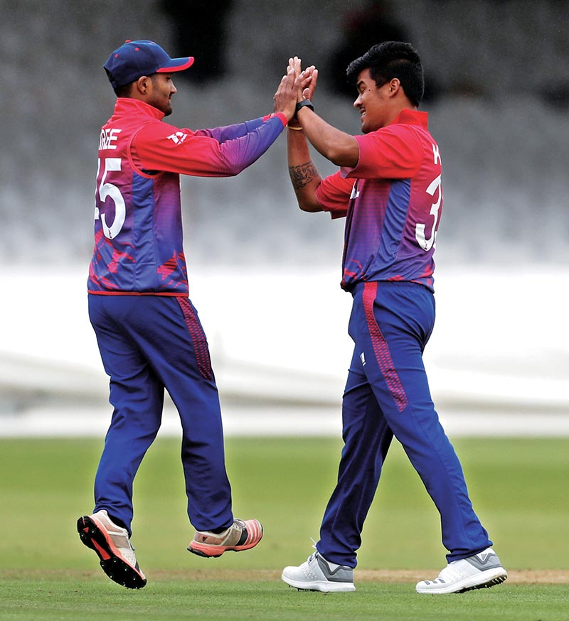 Nepal's Karan KC (right) celebrates with teammate after dismissing Netherland's Max O'Dowd during their MCC Twenty20 Tri-series match at the Lord's in London on Sunday. Photo: Reuters
