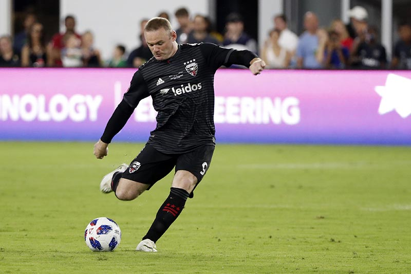 DC United forward Wayne Rooney (9) kicks a free kick against the Vancouver Whitecaps at Audi Field, in Washington, DC, USA, on July 14, 2018. Photo: Geoff Burke-USA TODAY Sports via Reuters