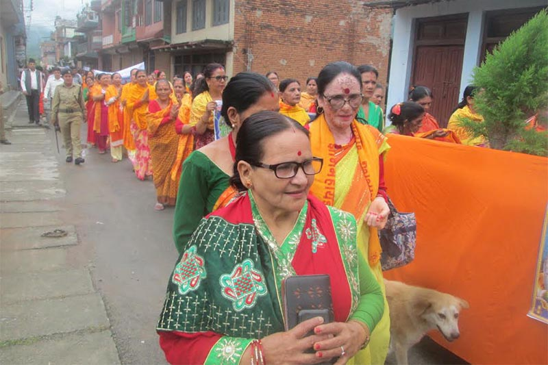 People participating in a religious procession taken out to mark the birth anniversary of Maharshi Guru Veda Byas, in Damauli, Tanahun, on Friday, July 27, 2018. Photo: THT