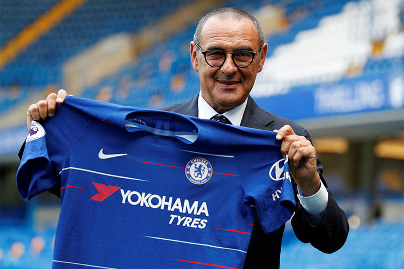 New Chelsea manager Maurizio Sarri poses with the club shirt after the press conference. Photo: Reuters