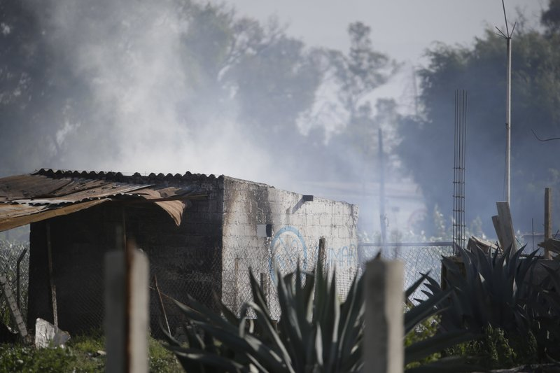 A building smolders at the site where several fireworks workshops blew up in Tultepec, Mexico, on Thursday, July 5, 2018. Photo: AP