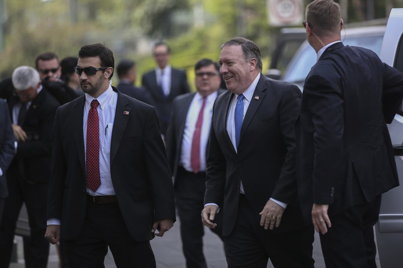 Secretary of State Mike Pompeo, second right, and staff arrive at Los Pinos presidential residence for a visit with Mexicou2019s President Enrique Nieto in Mexico City, on Friday, July 13, 2018. Photo: AP