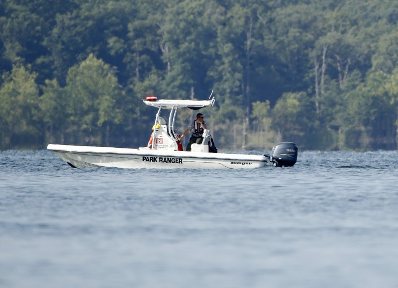 A park ranger patrols an area Friday, July 20, 2018, near where a duck boat capsized the night before resulting in at least 13 deaths on Table Rock Lake in Branson, Mo. Photo: AP