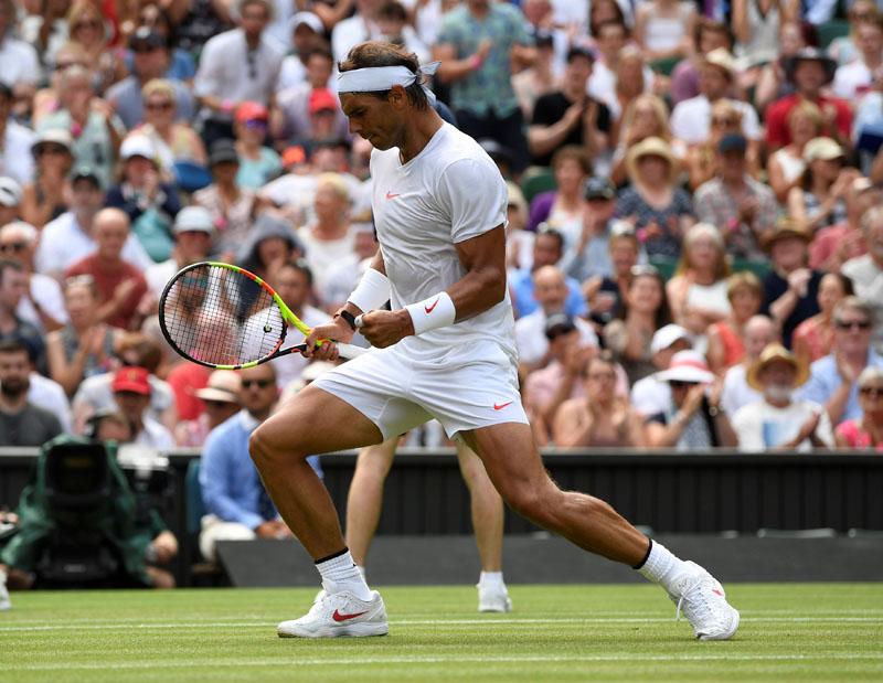 Tennis - Wimbledon - All England Lawn Tennis and Croquet Club, London, Britain - July 5, 2018  Spain's Rafael Nadal celebrates winning the second round match against Kazakhstan's Mikhail Kukushkin   REUTERS/Tony O'Brien