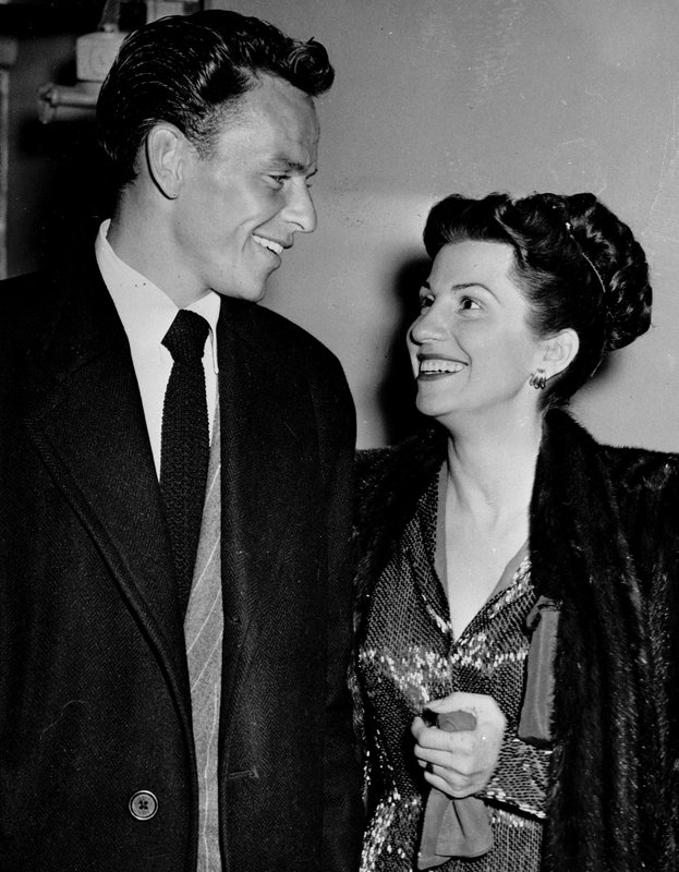 File - In this photo, singer Frank Sinatra and his wife Nancy smile broadly as they leave a Hollywood night club following a surprise meeting on Oct. 23, 1946. Photo: AP