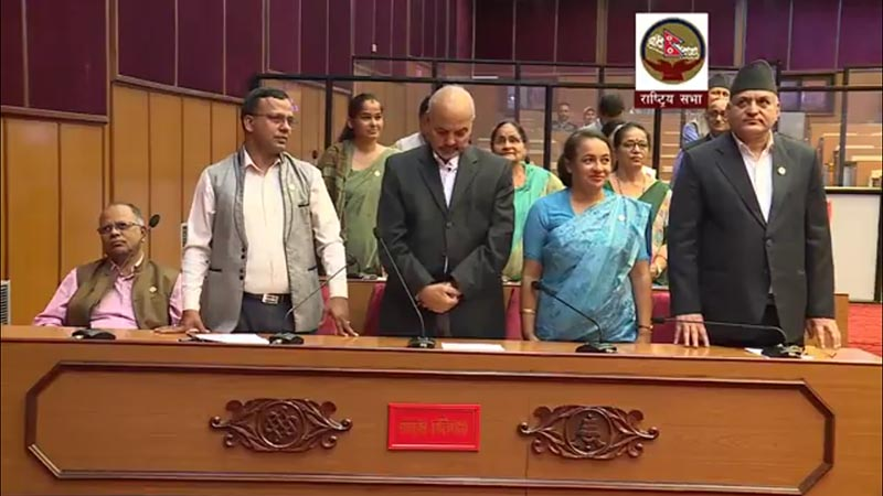 Nepali Congress lawmakers stand from their seats and obstruct the proceedings during National Assembly meeting, in Kathmandu, on Wednesday, July 25, 2018. Photo: Still image from National Assembly Youtube video