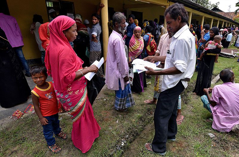 Villagers wait outside the National Register of Citizens (NRC) centre to get their documents verified by government officials, at Mayong Village in Morigaon district, in the northeastern state of Assam, India, on July 8, 2018. Photo: Reuters