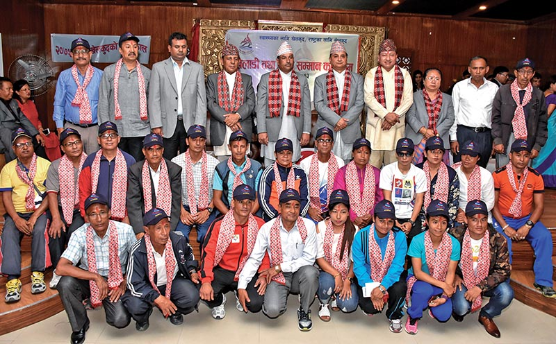 Nepal's Olympian athletes pose for group photo with officials at a felicitation programme of National Sports Council in Kathmandu on Sunday. Photo: Naresh Shrestha/ THT