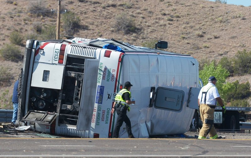 Emergency personnel work at the scene of a deadly multi-vehicle crash involving a bus that occurred on Interstate 25 north of Bernalillo, N.M., on Sunday, July 15, 2018. Photo: APn