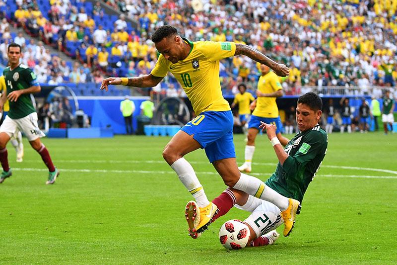 Brazil's Neymar in action with Mexico's Edson Alvarez. Photo: Reuters