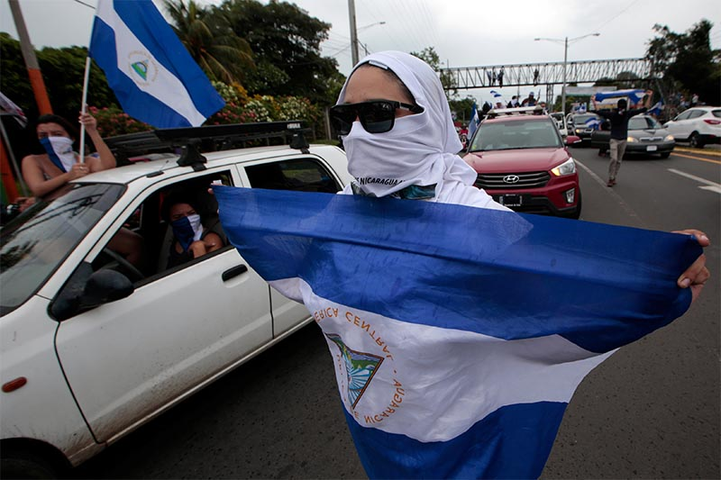 An anti-government protester takes part in a caravan of car and motorcycles to demand an end to violence in Ticuantepe, Nicaragua, on July 15, 2018. Photo: Reuters