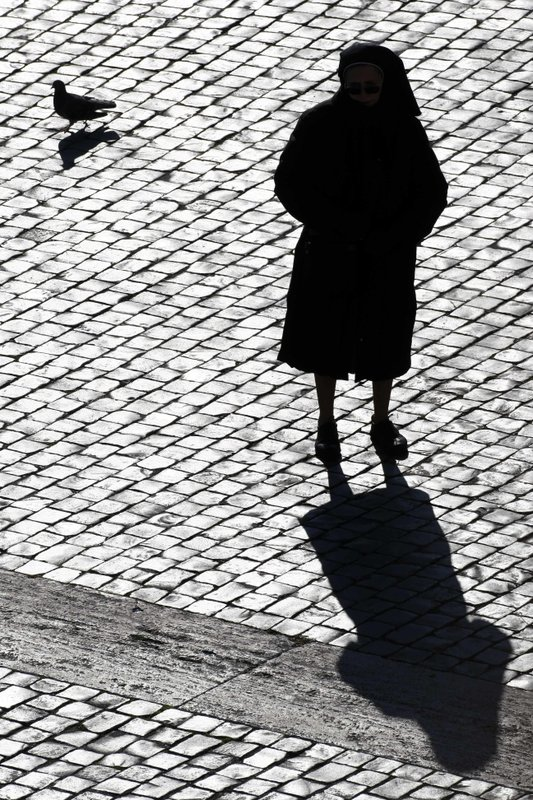 File - In this  photo, a nun is silhouetted in St. Peteru2019s Square at the Vatican on Sunday, Dec. 20, 2009. Photo: AP