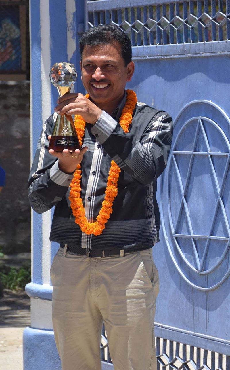 Principal of Oxford College of Engineering and Management, Hari Bhandari, displays 'International Star for Leadership in Quality 2018' award, in Gaindakot, Nawalpur, on Saturday, July 28, 2018. Photo: Tilak Ram Rimal