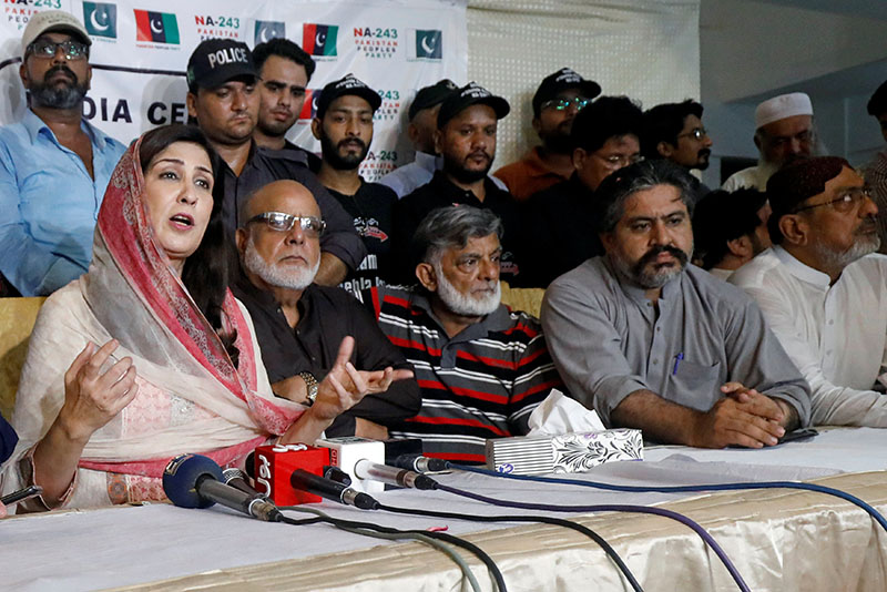 Syeda Shehla Raza (left), nominated candidate of Pakistan Peoples Party (PPP) for the National Assembly seat from Karachi, speaks with party workers during a campaign meeting ahead of general elections in Karachi, Pakistan July 10, 2018. Picture taken July 10, 2018. REUTERS/Akhtar Soomro