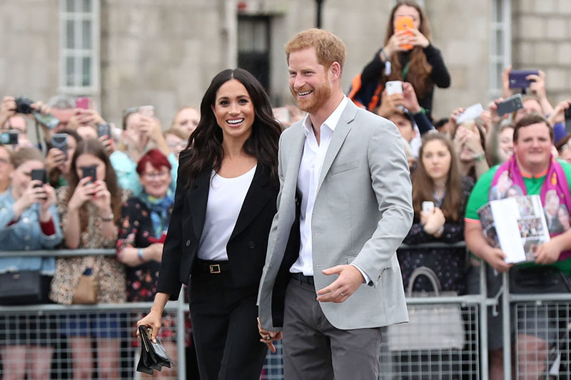 Britain's Prince Harry and Meghan, the Duchess of Sussex walkabout during a visit to Trinity College in Dublin, Ireland, July 11, 2018. Photo: Reuters