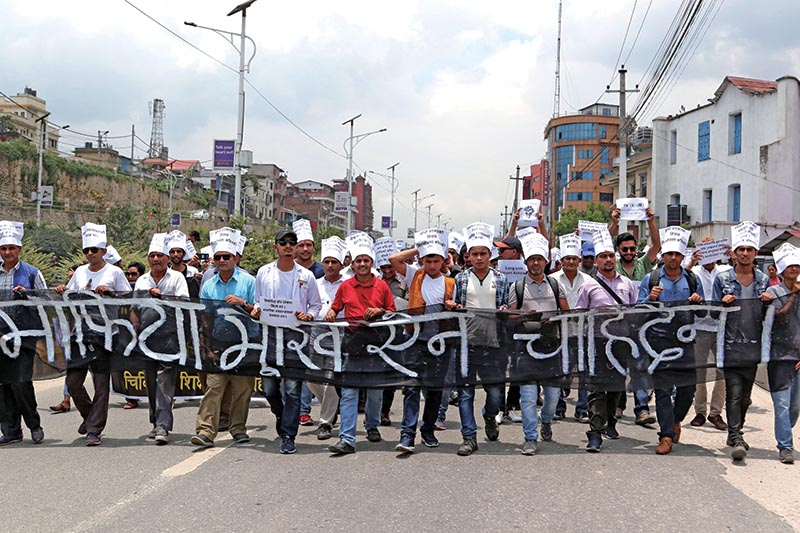 Supporter of Dr Govinda KC taking out a rally demanding that the government fulfil his demands, in Kathmandu, on Saturday. Photo: THT