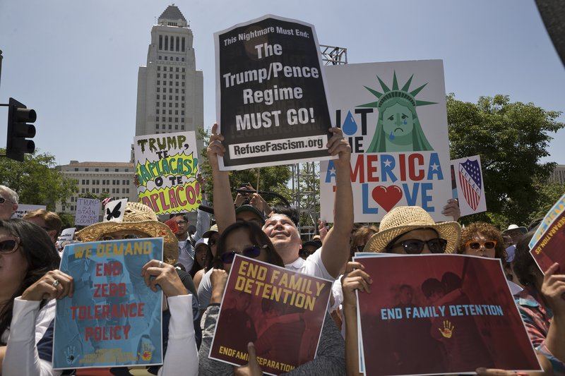 Protesters gather to demonstrate against President Donald Trumpu2019s immigration policies during the Families Belong Together - Freedom for Immigrants March in downtown Los Angeles on Saturday, June 30, 2018. Photo: AP