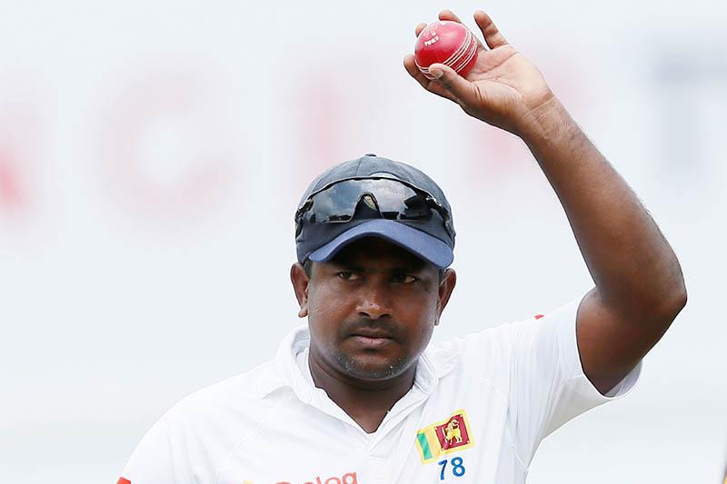 Sri Lanka's Rangana Herath shows the ball to celebrate taking six wickets after Sri Lanka won the test series. Photo: Reuters