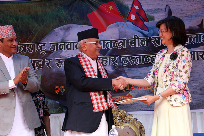 Prime Minister KP Sharma Oli handing over documents to Chinese Ambassador to Nepal Yu Hong for presenting a couple of rhinos - Bhadra and Rupasi - to China, amid a programme, in Kathmandu, on Thursday, July 12, 2018. Photo: RSS